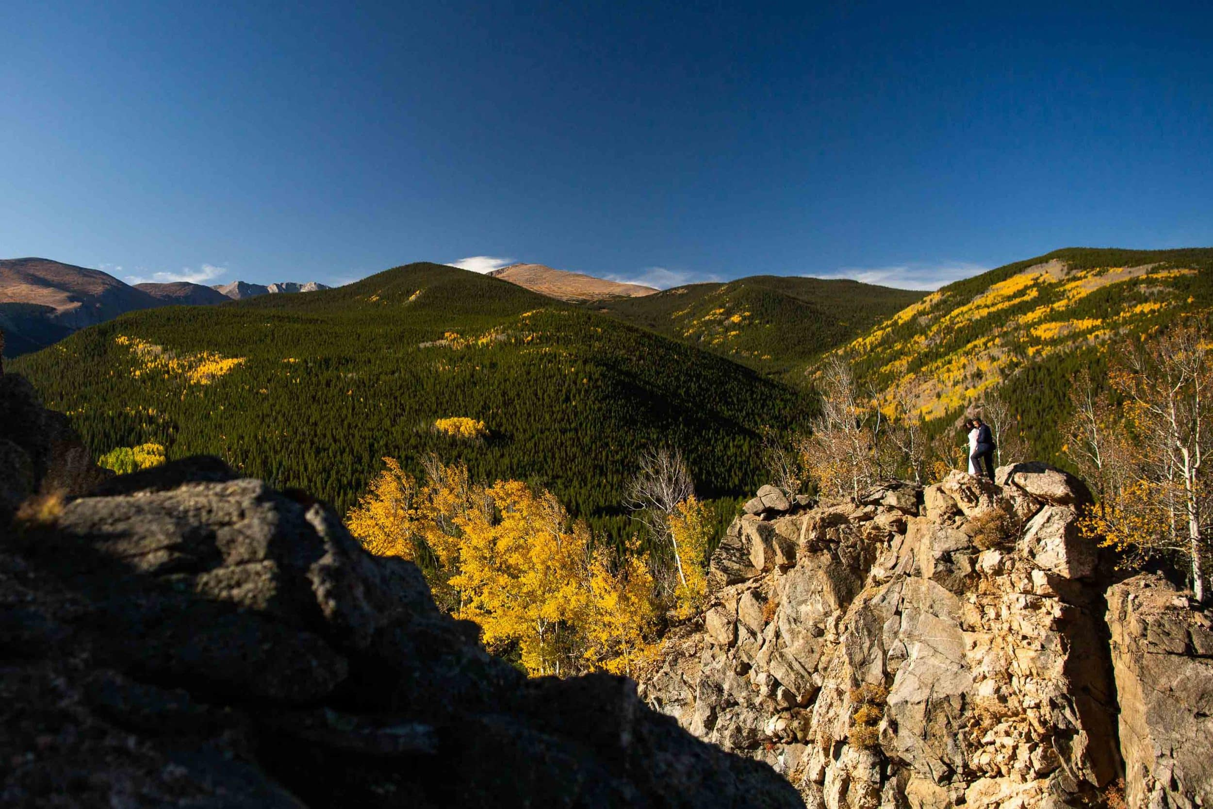 A fall elopement with Mt. Evans in the background.