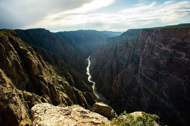 The gunnison river cuts through the black canyon's dark walls.