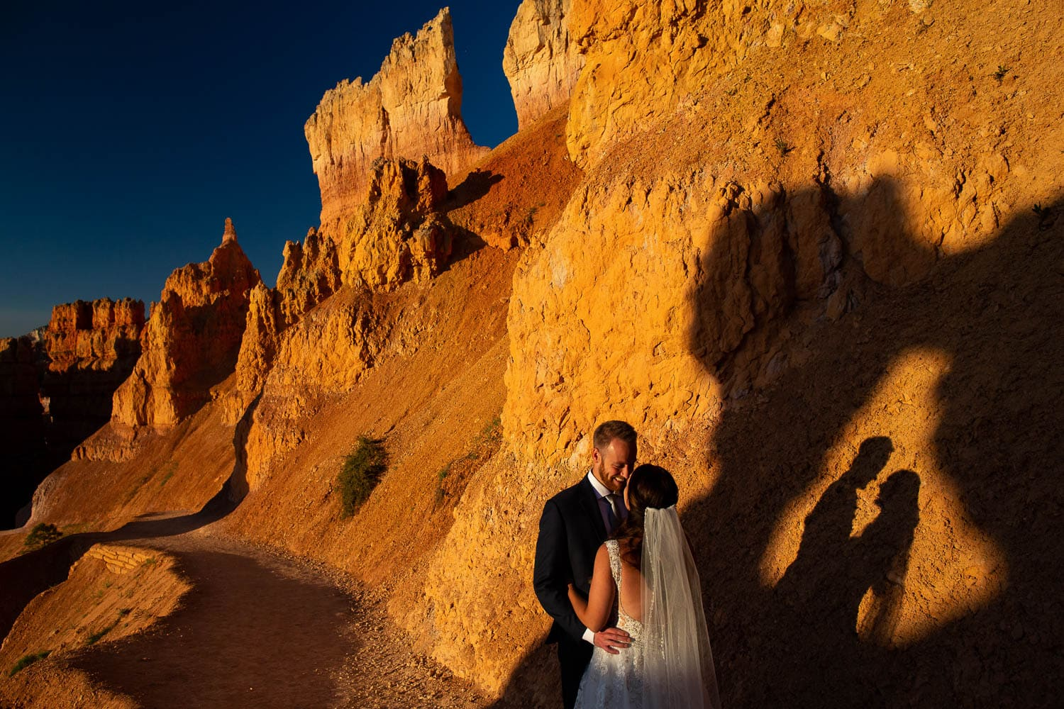 A bride and groom eloping at sunrise in bryce canyon national park.