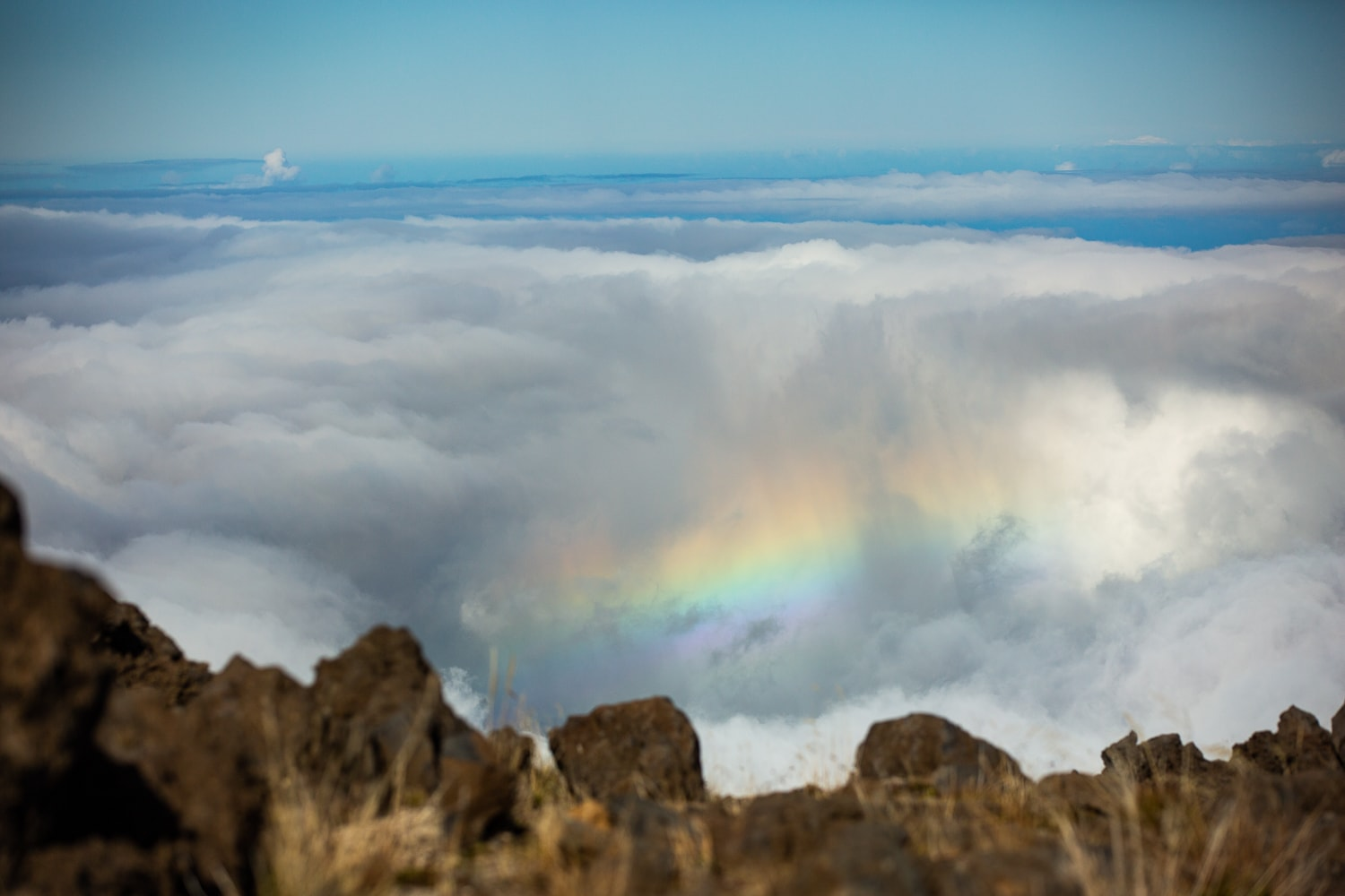 A rainbow above the clouds from Haleakala summit.