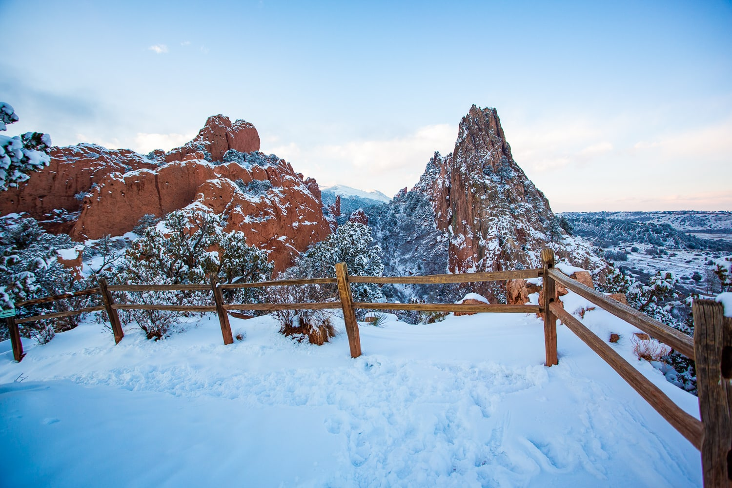A valley between two red rock formations at Garden of the Gods in winter time.