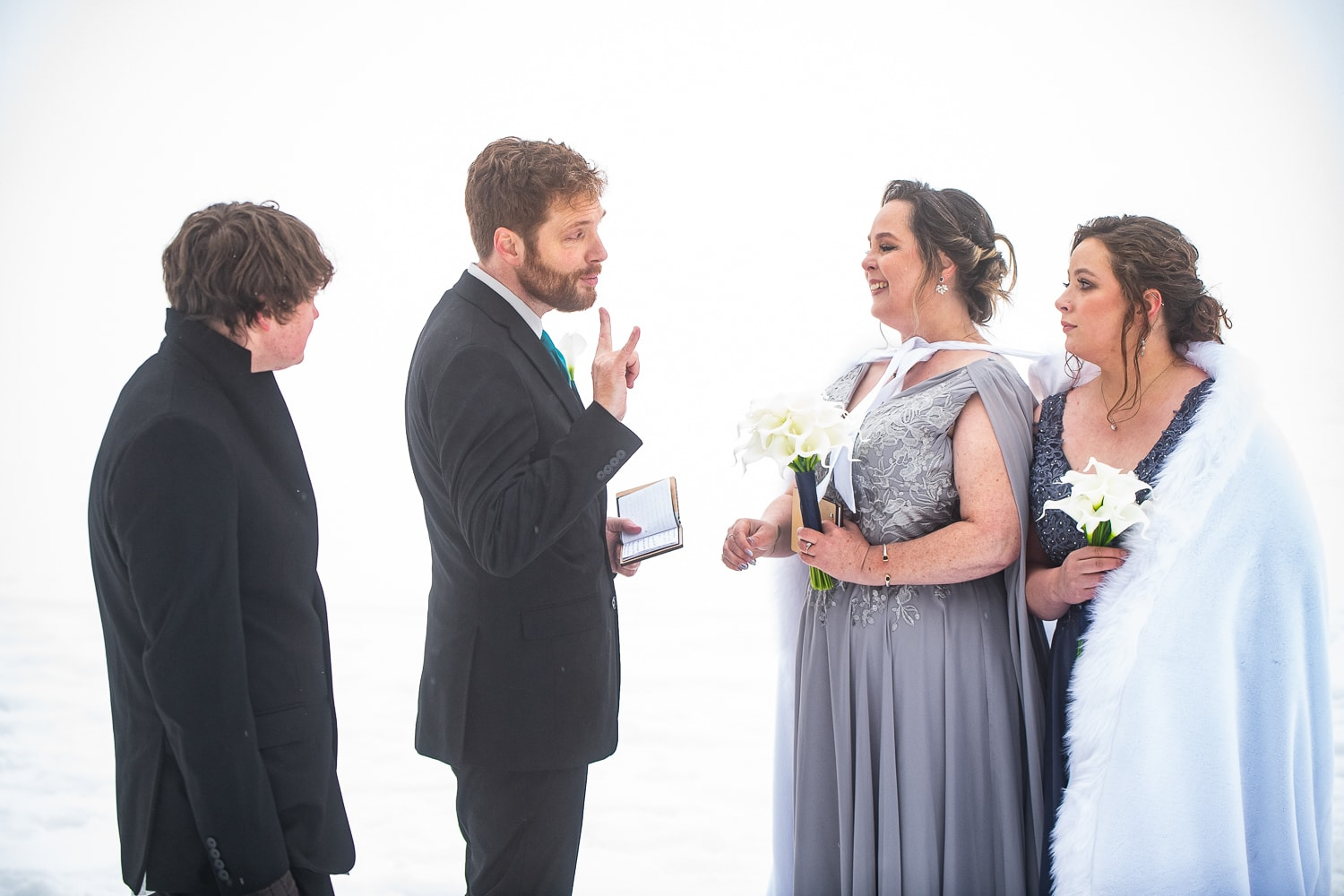 """A groom says """"I love you."""" in sign language as part of his elopement vows."""