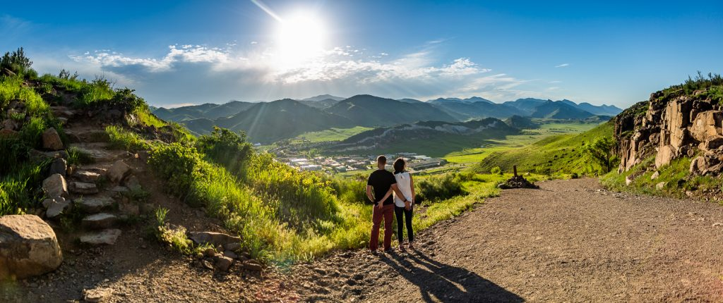 A couple looks out over the town of Golden, Colorado