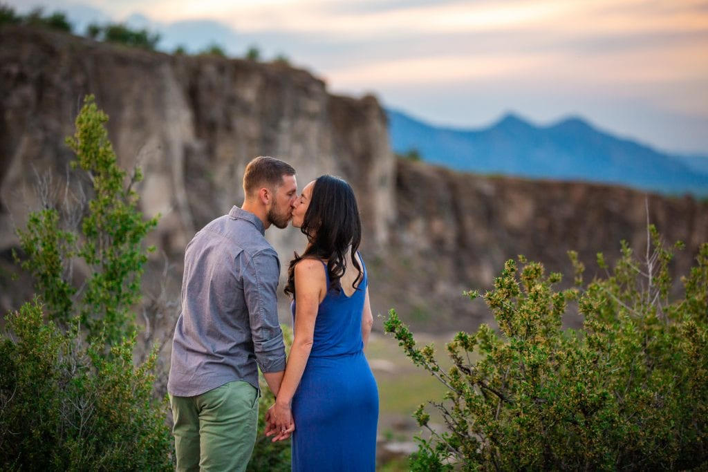 an engagement photo on a cliff in Golden, CO.