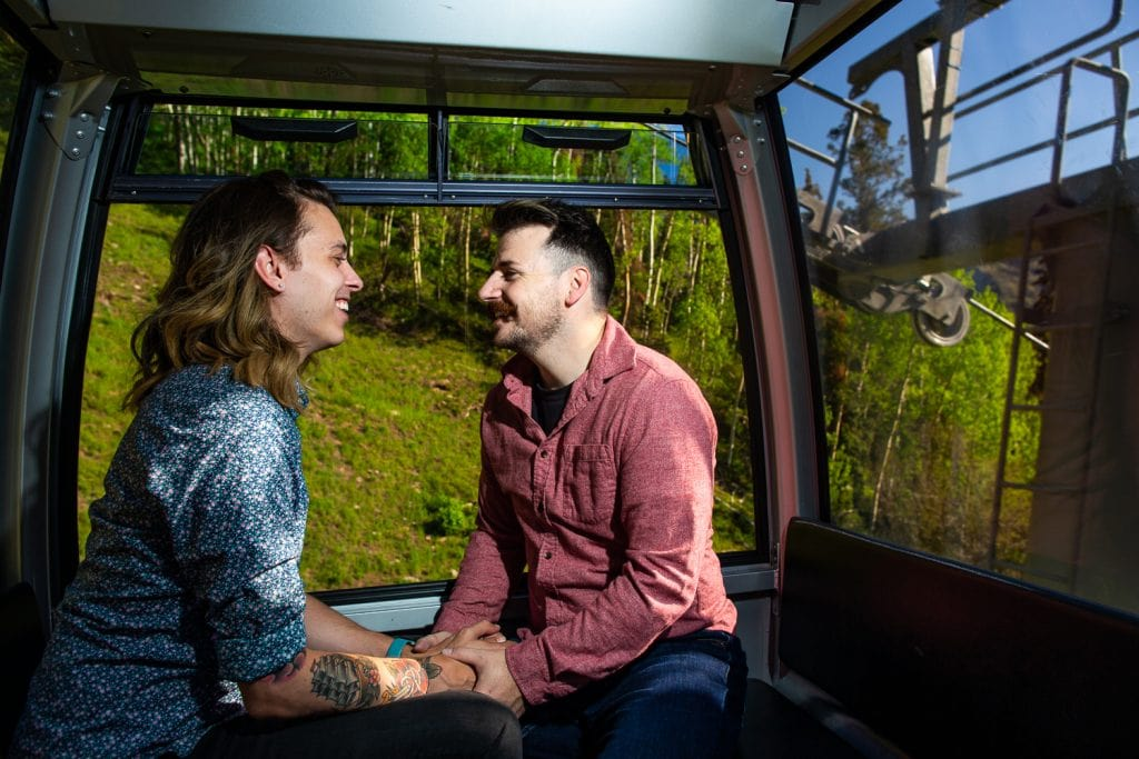 An engagement photo in telluride's free gondola.