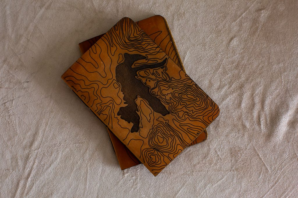 Handcrafted leather vow books for writing your elopement vows in.