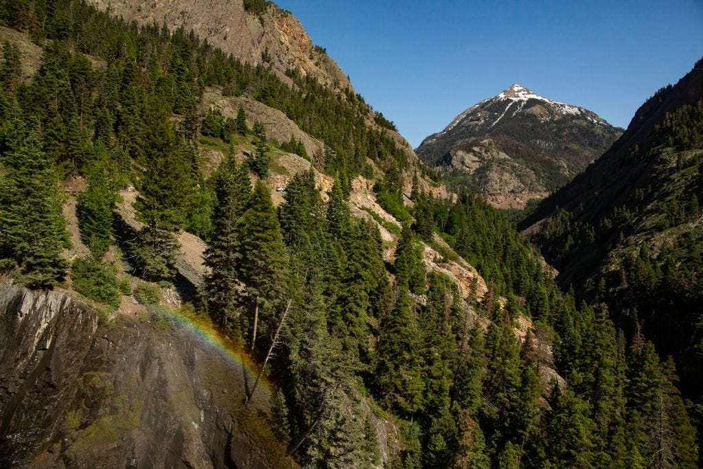 A rainbow over a waterfall in Ouray, Colorado.