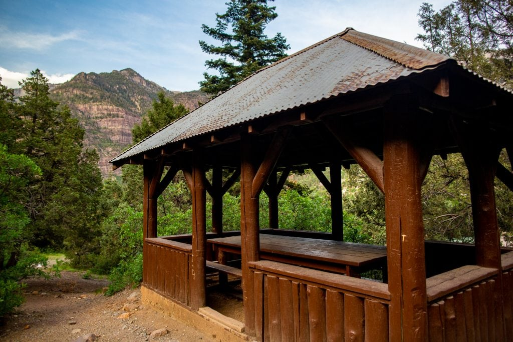 A covered picnic table in Ouray, colorado.