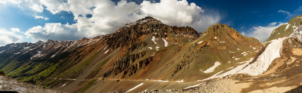 A dirt road cuts across a 12,000ft ridge in Ouray, Colorado.