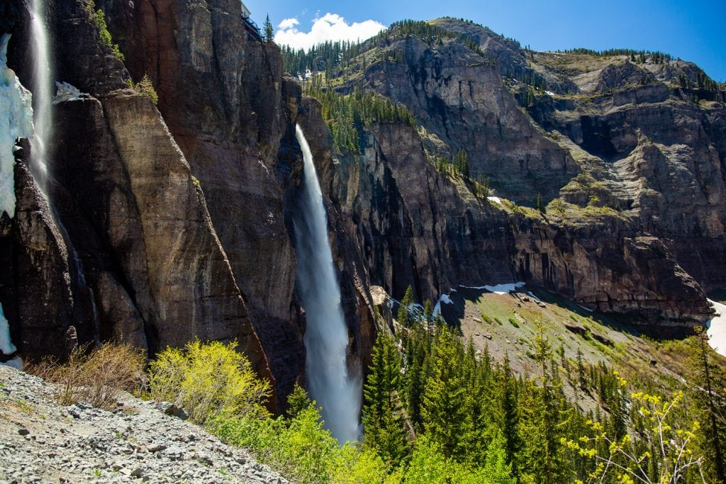 A huge waterfall tumbles off a cliff in Colorado.