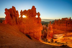 A colorful photograph of Bryce canyon at sunrise