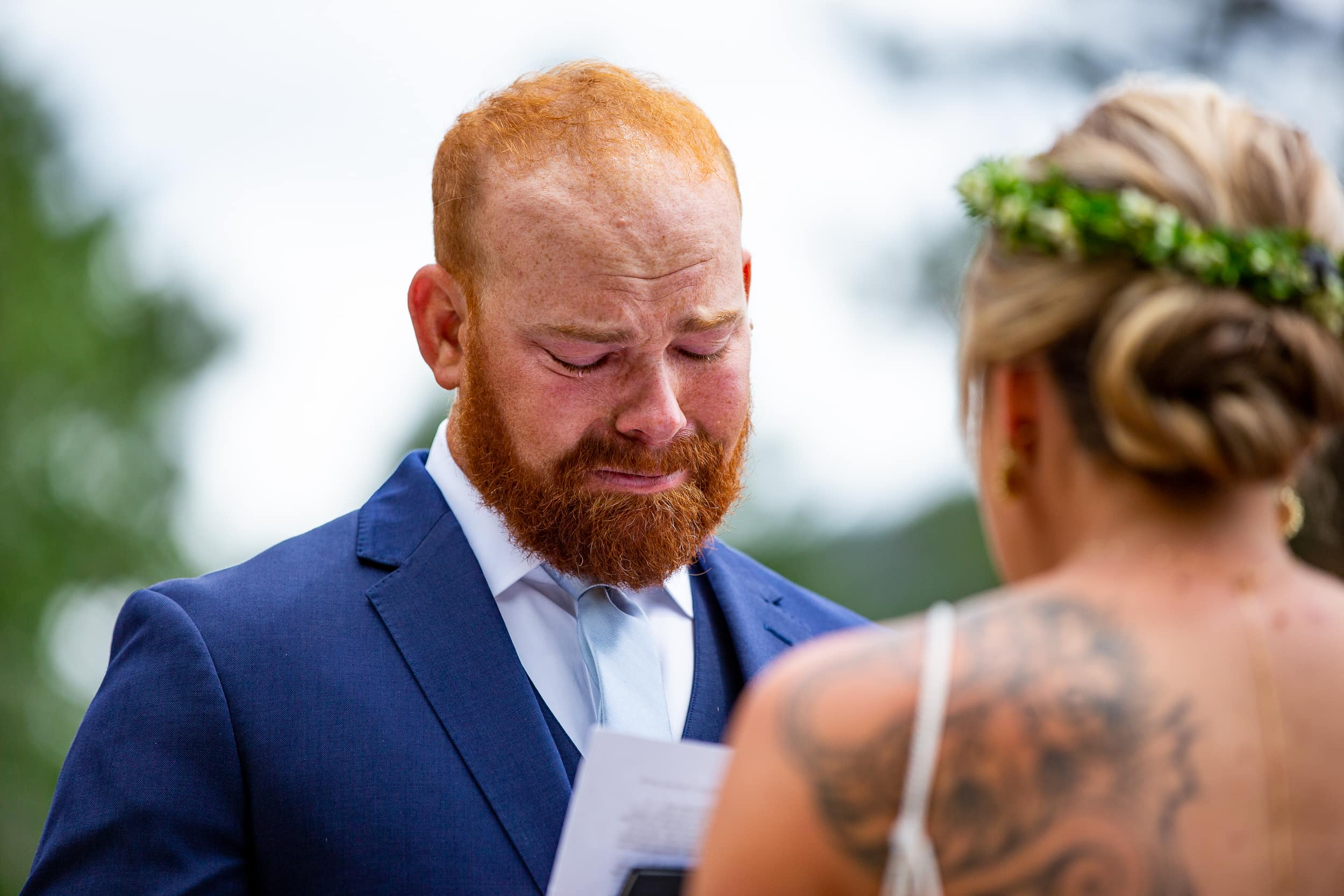 Kevin gets emotional as he reads his vows to Jamie in Estes Park, Colorado.